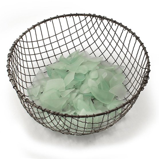 The final step of making your own sea glass is dumping the sludge from the barrel into a colander with large holes and rinsing until only the clean, large pieces of sea glass remain in the colander.