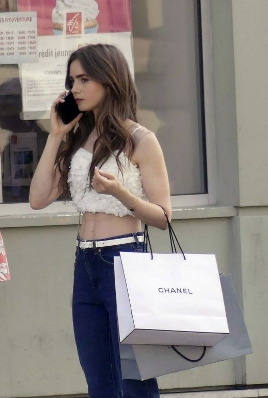 LILY COLLINS on the Set of Emily in Paris in Paris 08/28 ...