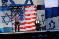 """ד""""ר עמית גופר מציג את reawalk בכנס של אייפק בתחילת 2013. צילום יח""""צ"""