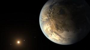 """ציור אמן של כוכב הלכת קפלר -186f, כוכב הלכת הראשון בגודלו של כדור הארץ המקיף את השמש שלו באיזור החיים, אחד מהתגליות האסטרונומיות של שנת 2014. איור: מרכז איימס של נאס""""א, מכון סט""""י, JPL-קאלטק"""