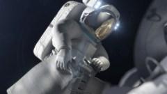 """אסטרונאוט מאחסן דגימה מהאסטרואיד. קרדיט: נאס""""א והמעבדה להנעה סילונית במכון הטכנולוגי של קליפורניה"""