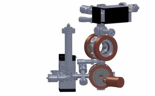 מערכת ניסוי אולטרה-קרה, שמורכבת משני תאי ואקום. בתא העליון, האטומים הלכודים מקוררים לכדי כמה מיליוניות של מעלת קלווין. בתא השני, האטומים לכודים בשנית ומעורבבים עם יון אולטרה-קר יחיד.