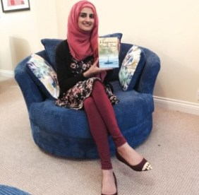 Safiya Hussain with her book