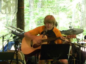 Music Camp - Camper plays guitar.