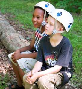 Photo of Two Boys at Day Camp Wearing Helmets