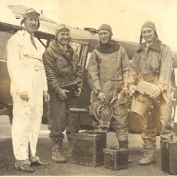1932 - Photograph of small airplane with four eclipse observers including Buck Baron