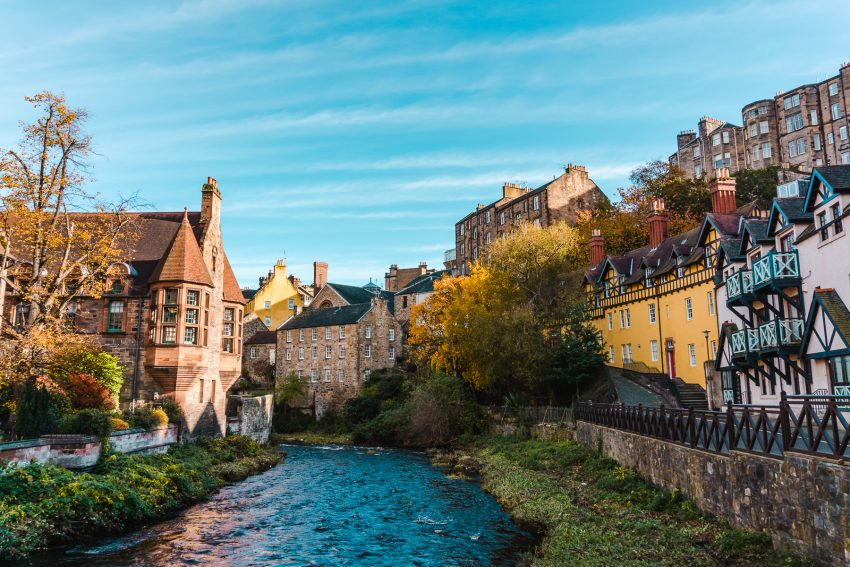 Pretty houses along the river, backdropped by a blue sky in Dean's Village in Edinburgh, Scotland