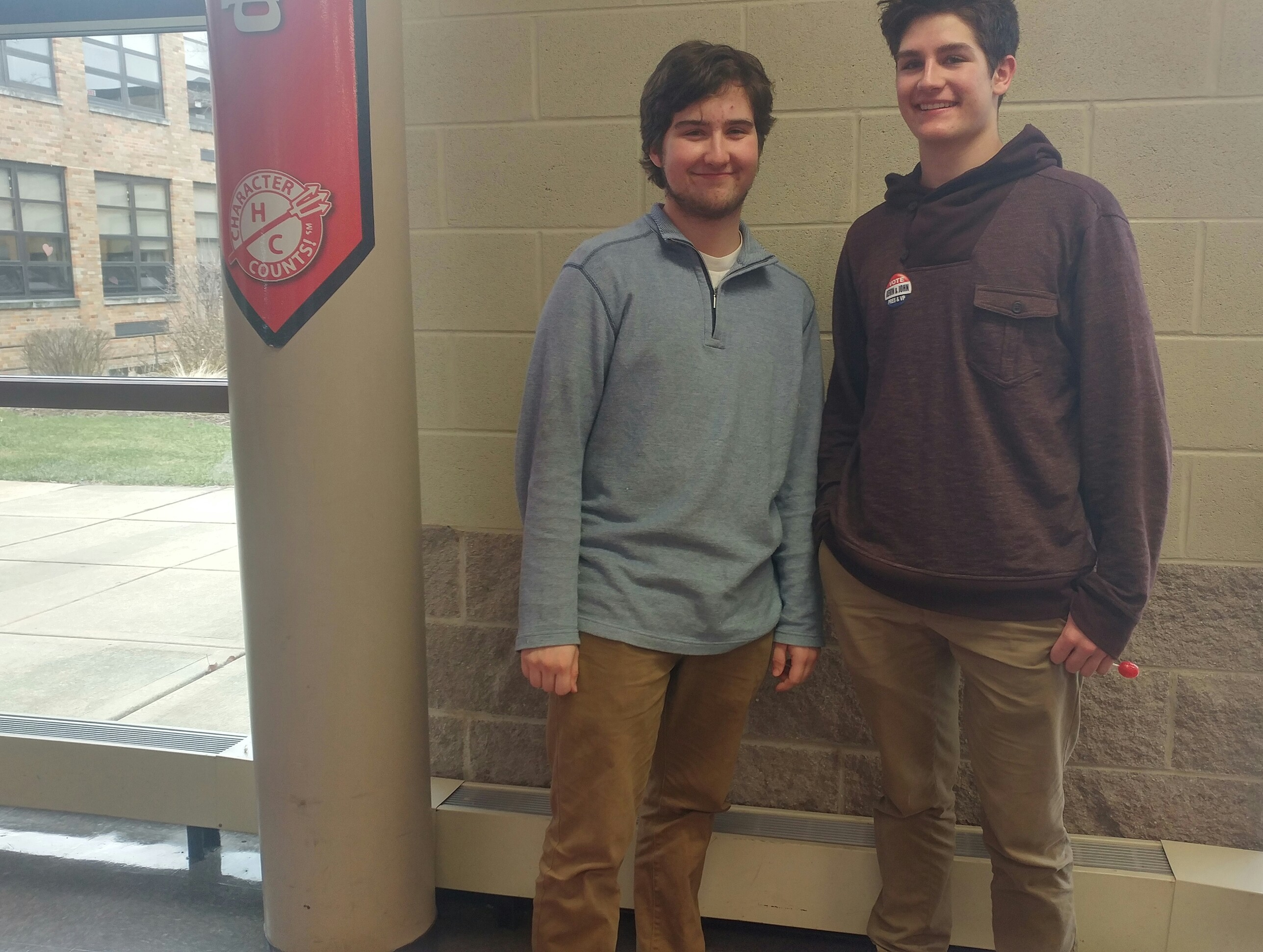 Students Ben Griffith, senior, and Connor Bower, junior, choose khakis and colored pullovers for a spring outfit.