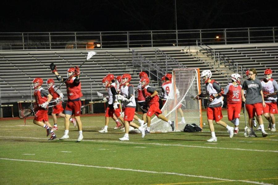 Boys%27+Varsity+Lacrosse+practices+on+Dickinson+field+on+the+evening+of++March+8.