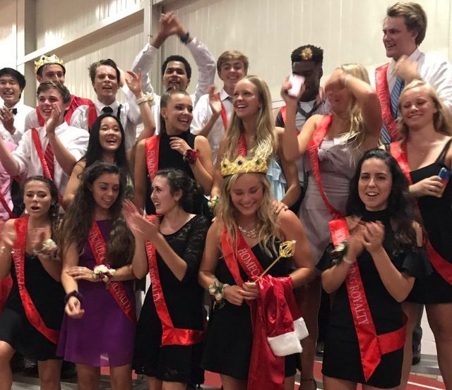 The+court+celebrates+at+the+dance+after+Marshall+Demirjian+and+Kelly+Nash+were+crowned+2017+Homecoming+King+and+Queen.