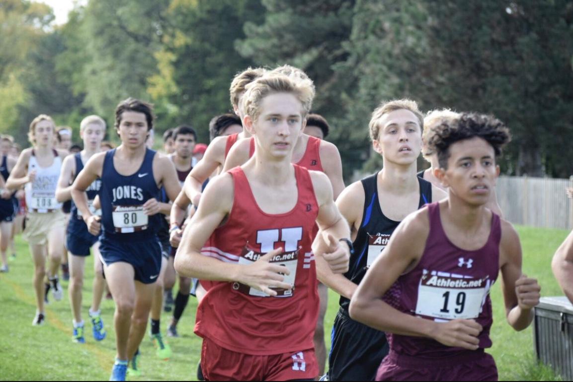 Matt Kusak, junior member of the varsity boys cross country team, runs during a previous meet.