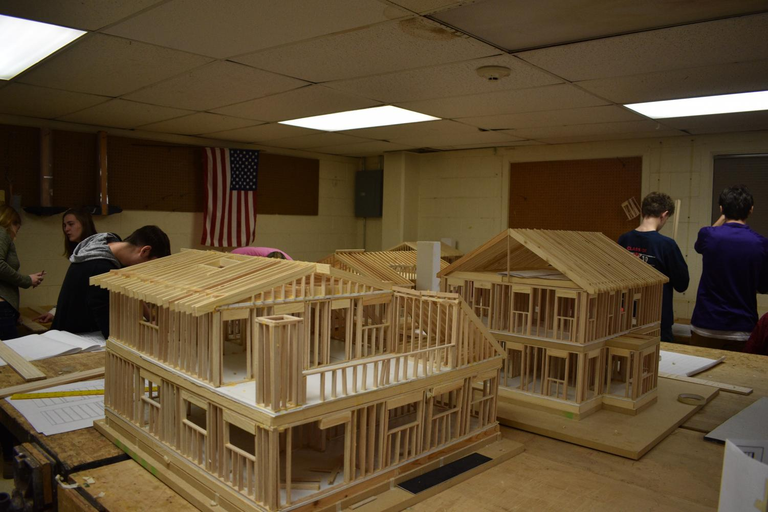 Architecture & design classes work on making models of houses.