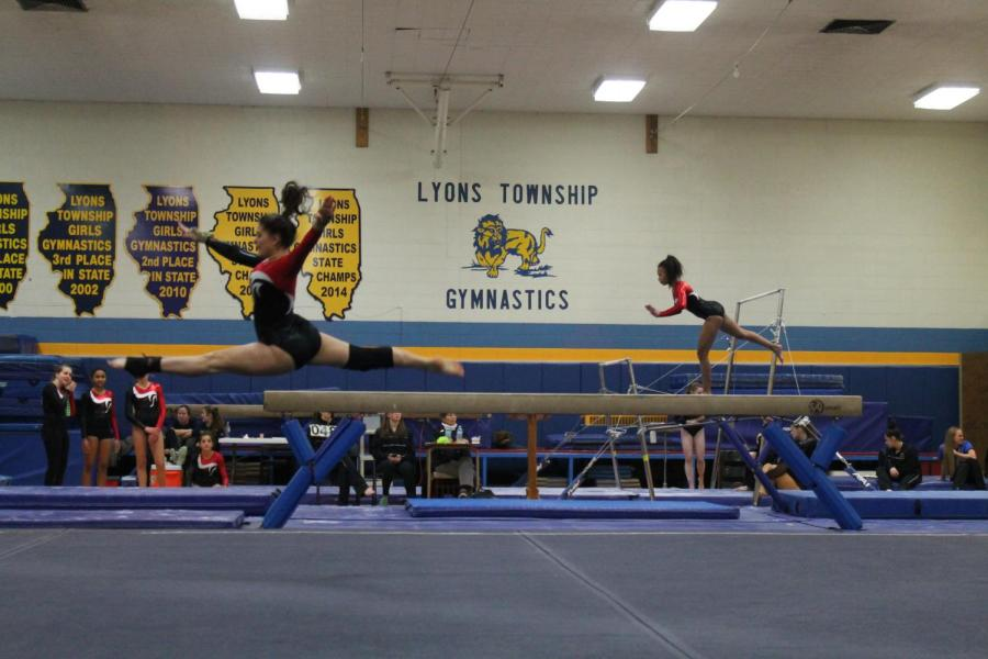 Sophomore+Emma+Baroni+%28left%29+performs+her+floor+routine+at+the+meet.+