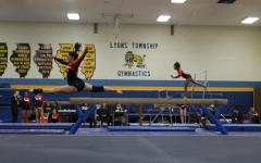 Girls gymnastics defeats rival Lyons Township