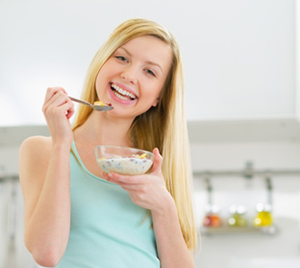 Lady eating food in a bowl,The Loading Phase