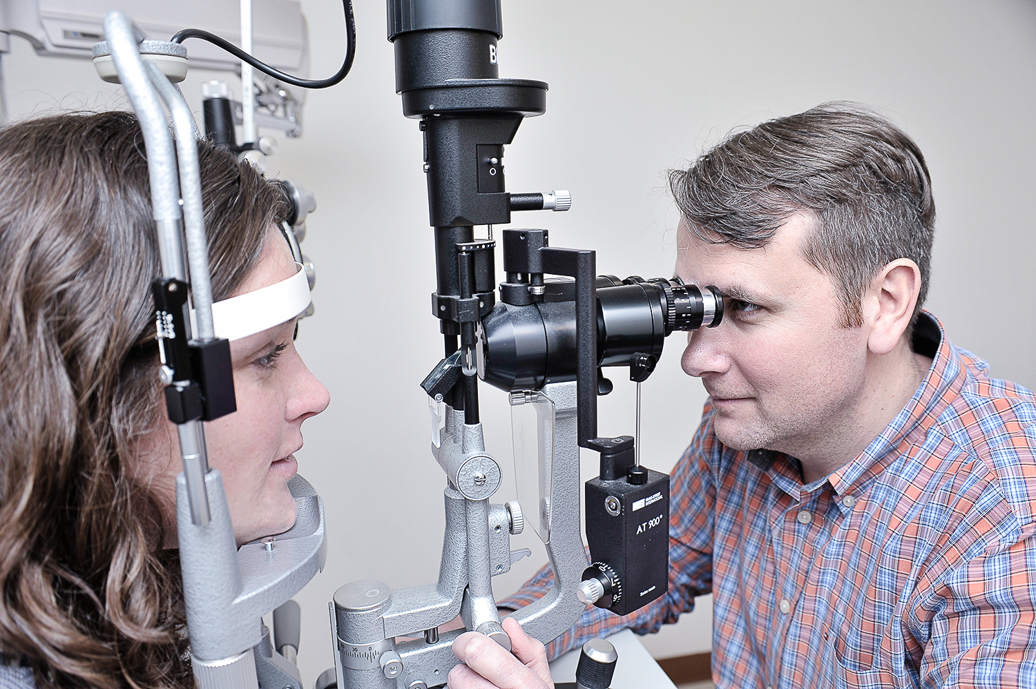 Photo of Dr. Purdy examining a patient.