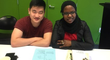 Mariam and her tutor Ray enjoy the celebration at the Central Library