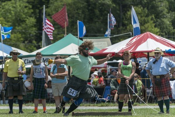 Wes Kiser prepares to throw a 56-pound weight for distance at the 61st annual Grandfather Mountain Highland Games. Kiser finished second overall in the professional Scottish heavy athletics portion of the Games. Photo by Skip Sickler | Grandfather Mountain Stewardship Foundation