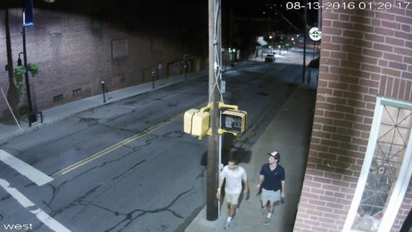This is an image captured by the Tsunami camera currently installed at King and Depot streets in August when the person wearing a hat stole a patio umbrella from Lost Province Brewing Co.