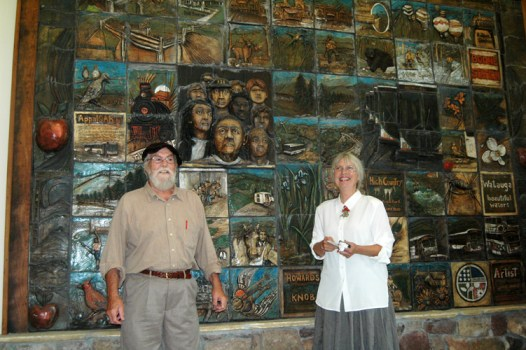 Keith Lambert and Willie Baucom stand in front of the clay mural they crafted that is inside of the new AppalCART facility off of N.C. 105 Bypass. Photo by Jesse Wood