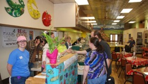 The first customers at the F.A.R.M. Cafe on the grand opening in May 2012. Photo by Jesse Wood