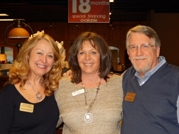 Barbara Armstrong, manager of Admin Services, Dan Meyer, President of the Boone Area Chamber and Terry Wyatt, general manager of Badcock Furniture and More