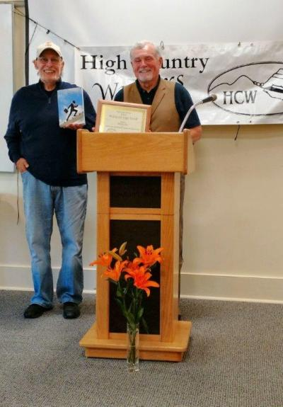 Bill Runyon receives his Book of the Year Award from Wayne Clawson. Photo by Ree Strawsman.