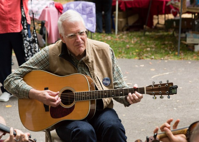 Incumbent Boone Town Council Candidate Rennie Brantz plays guitar in the jamming area. Photo by Lonnie Webster