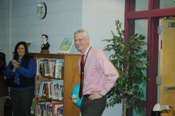 Principal Toby Cone as he walks into the surprise that awaited him on Monday. Photo by Jesse Wood