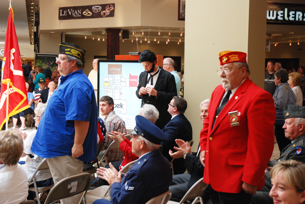 Veterans stand when his service song is played at the ceremony.