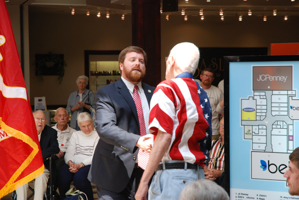 Mayor Andy Ball shakes Sonny Sweet's hand.