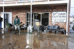 Cleanup efforts began at Bob's Hair Cutters and other businesses along Boone Docks Drive last Thursday and continue still. Photo by Ken Ketchie