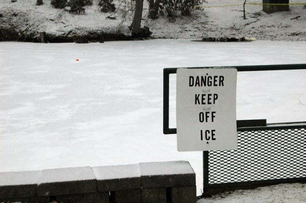 A sign warns college students to stay off of the Duck Pond on the campus of ASU.