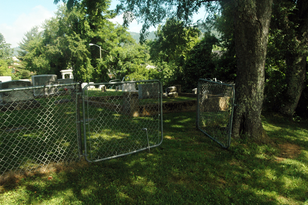 To get to the unfenced black section of the cemetery, you must walk through this gate.