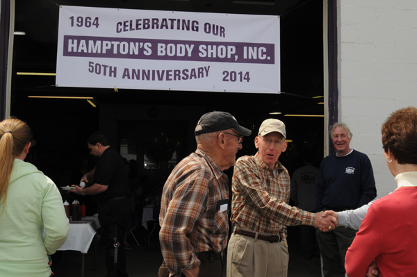 The good ole boys standing around Hampton's Body Shop at the 50th anniversary celebration.