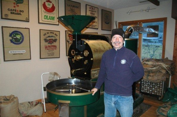 Cox stands next to Lucille the Roaster in the Valle Crucis shop in 2014 when High Country Press visited.