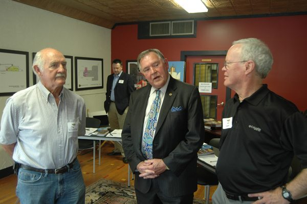 Appalachian Theatre of the High Country Chair John Cooper (right) speaks with the Dr. Joe Edmisten (far left) and his brother Rufus Edmisten, the former N.C. Secretary of State and Attorney General. Photo by Jesse Wood