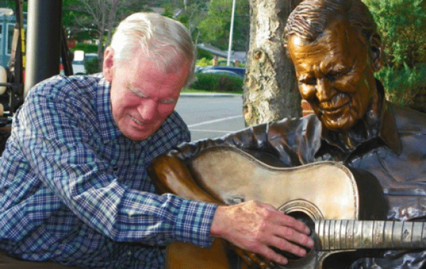 Doc Watson with statue