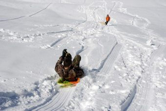 Some kids enjoying a snow day on Friday in the High Country. Photo by Ken Ketchie