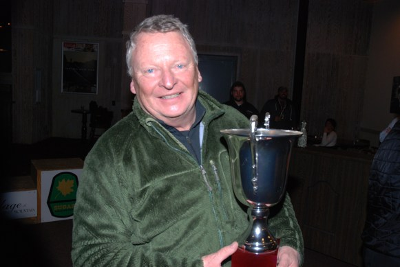 Owner of Sugar Mountain Resort Gunther Jochl stands proud with the trophy for the winning ski team.