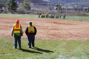 Inmate work crews assisting the Watauga County Parks and Recreation Department get the ball fields repaired and ready. Photo by Ken Ketchie