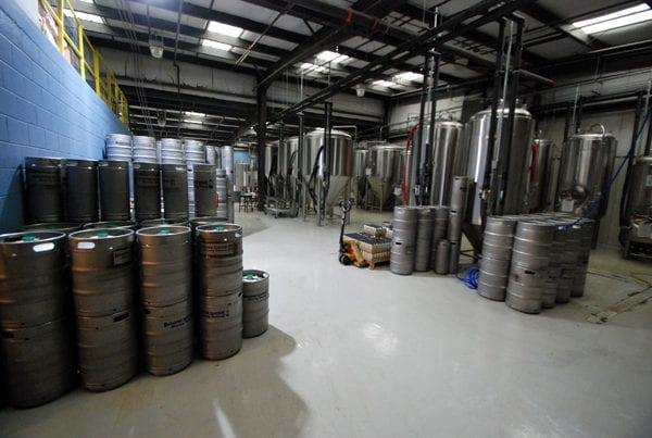 The brewery has plenty of beer in kegs waiting to distribute to their patrons.