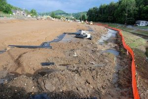 The redevelopment of property between Blowing Rock Road and Faculty Street includes daylighting of the stream and a parking deck.