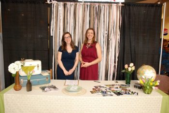 "Wedding consultants from ""The Whole Shebang"" share ideas at the annual wedding expo in 2015."