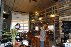 Speigelman stands inside Appalachain Mountain Brewery a day before it opens. Photo by Ken Ketchie