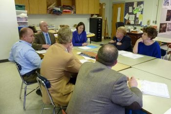 Board of Education members at Hardin Park School with Dr. Scott Elliott (at far end of table on left), Principal Mary Smalling (far end on right), and central office personnel