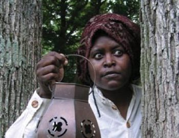 "Harriet Tubman is portrayed in Bright Star's peformance of ""Heroes of the Underground Railroad."""