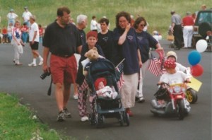Image is attached of Luke Hancock, 2001 Banner Elk July Fourth Parade with the McKays and Hardins. He took the prize for best float for children and won a bag of cookies. Kathy Boone is in the far left upper quarter. Mike, Pam, Morgan (On the motor cycle) Mason (in the stroller).  Susan and Ed Hardin are behind us.