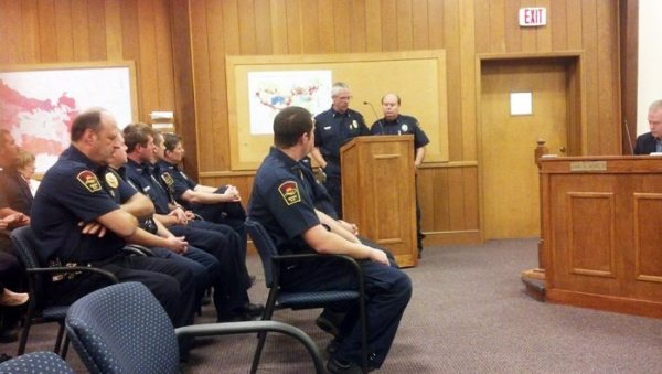 Boone Fire Chief Jimmy Isaacs presents speaks admiringly of retiring Ronnie Marsh at a Boone Town Council meeting on Tuesday.