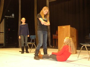 """Rehearsal from """"Last Testament"""" (L to R) Savannah Troyer, Lucy Gray, Katie Williams. Photo courtesy of Ensemble Stage"""